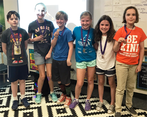 Six students with medals
