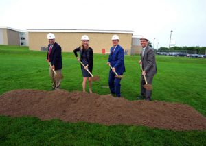 Four board members with shovels.