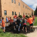 Students working with mulch